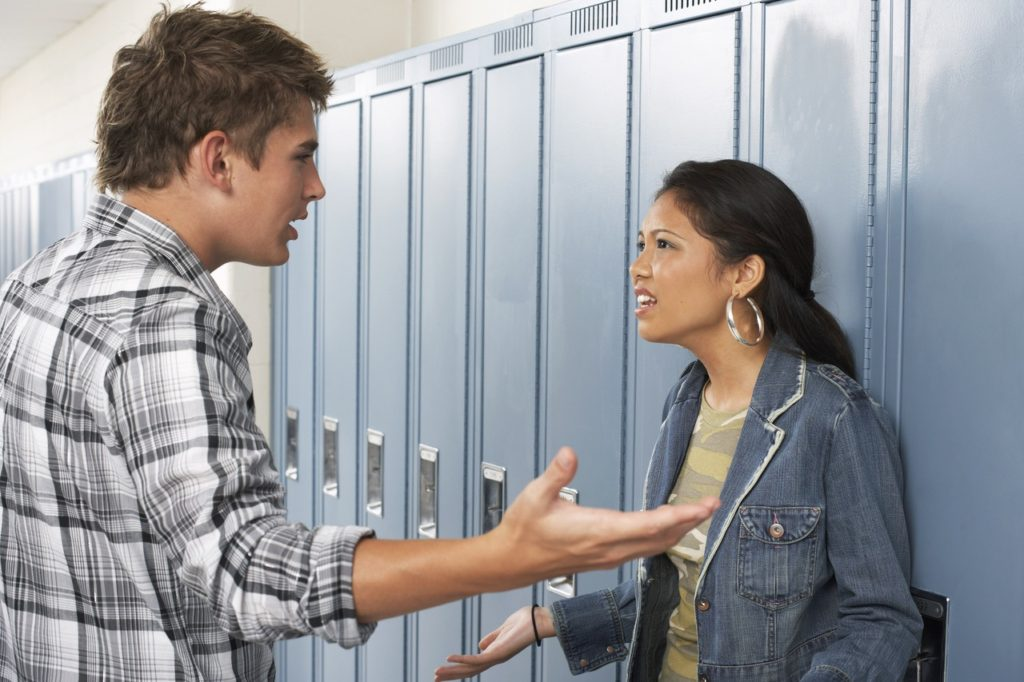Couple Fighting at School --- Image by © Radius Images/Corbis